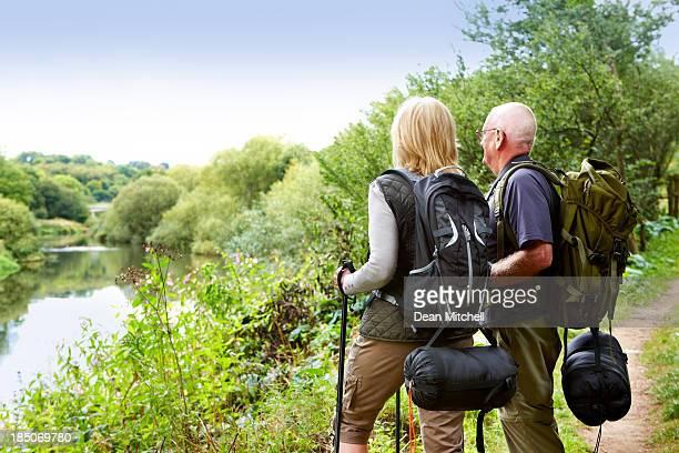 Active senior hikers looking at a view