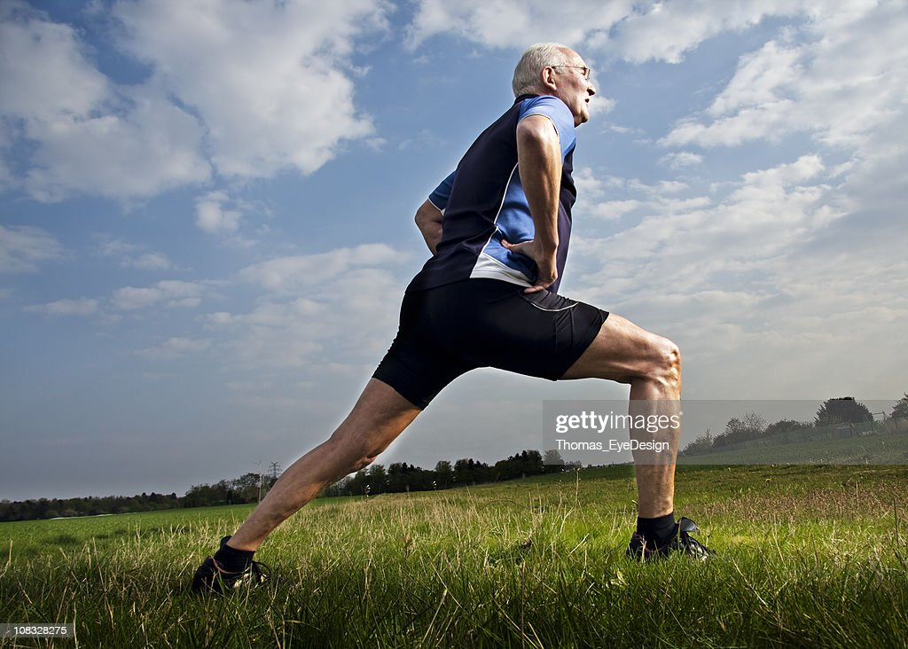 Active Senior Male Stretching : Stock Photo
