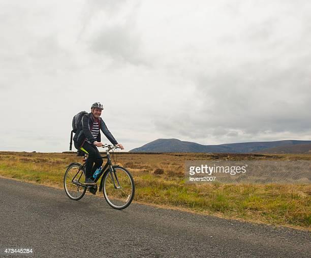 Active senior man cycling in nature
