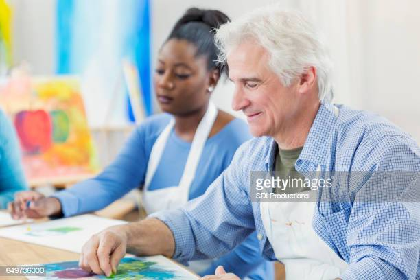 Active senior man in art class