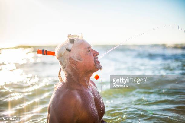Active senior man in the ocean
