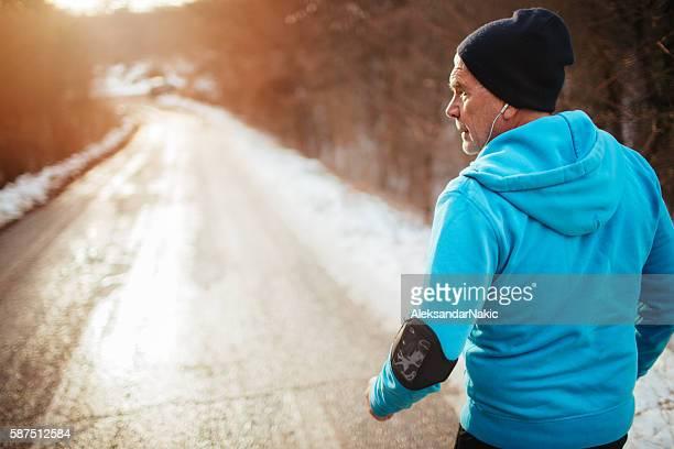 Active senior man jogging