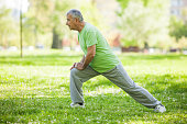 Senior man is exercising in park. Active retirement.