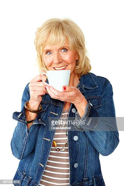 Active senior woman drinking hot coffee