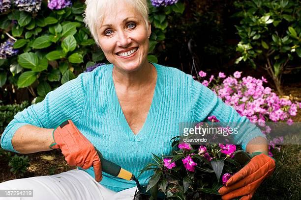 Active Senior Woman Gardening, Copy Space