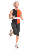 Running senior woman in front of white background