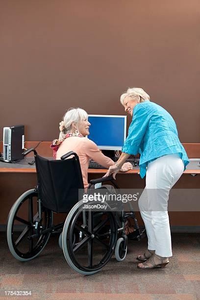 Active Seniors At Computer Station