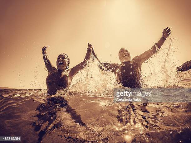 Active seniors bathing in the sea