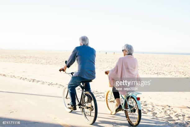 Active seniors couple on bike
