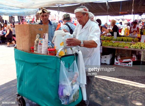 Active Seniors, still working at the market, by a hot summer day