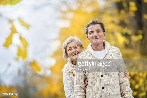 Active seniors taking walk in nature : Stock Photo