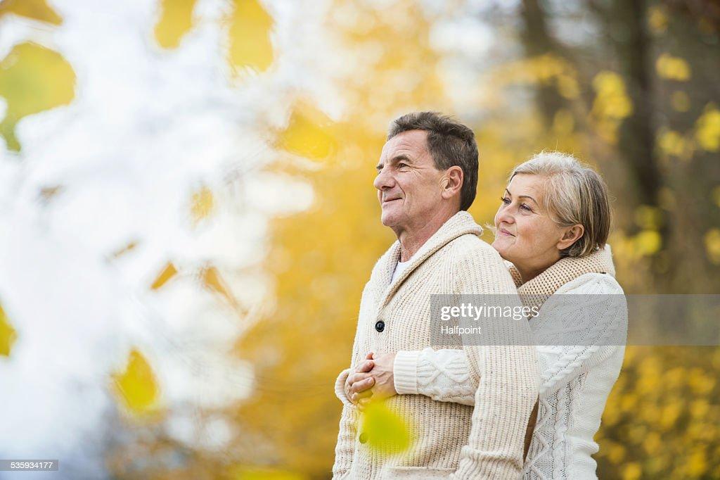 Active seniors taking walk in nature : Stock Photo