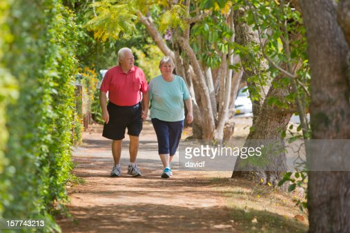 Active Seniors Walking and Holding Hands