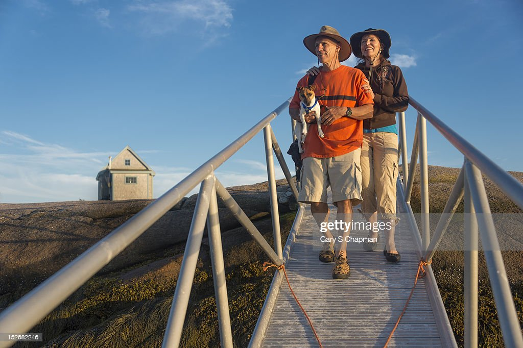 Active seniors walking down gangway to dock : Stock Photo