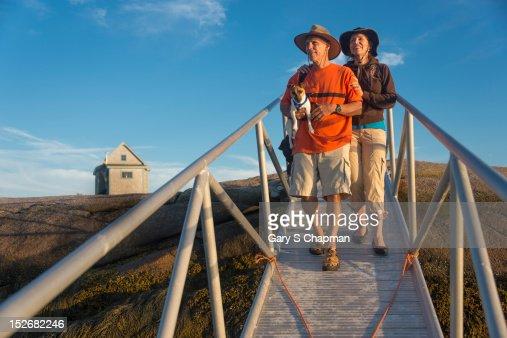 Active seniors walking down gangway to dock : Stock Photo