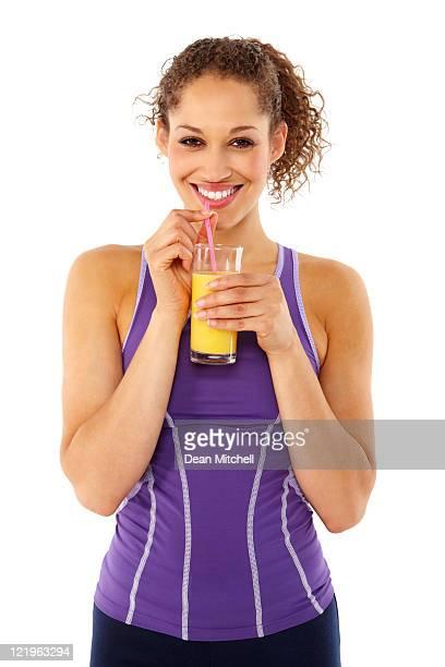 Active Woman Drinking Orange Juice - Isolated