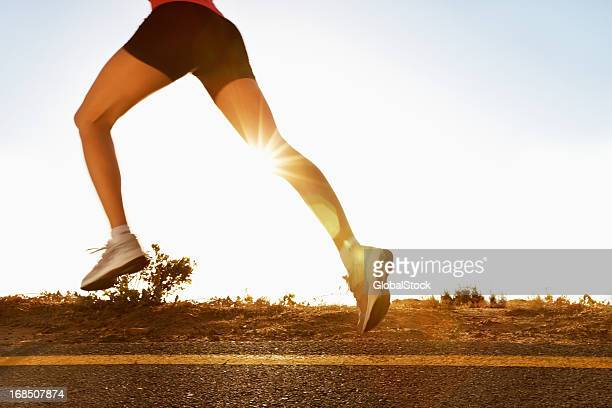 Active woman running in the countryside