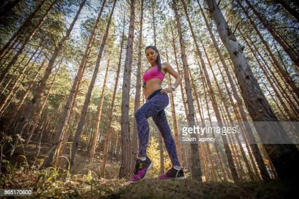 Active woman standing in autumn nature