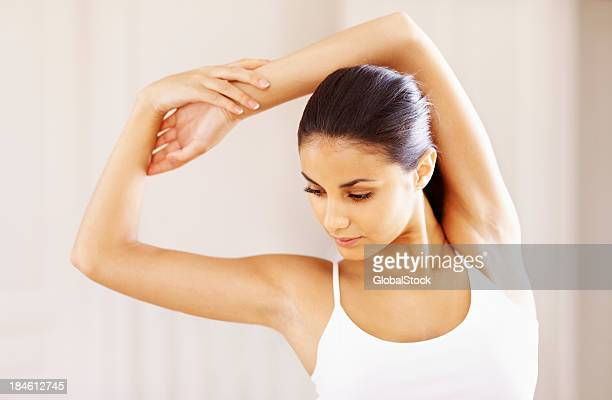 Active woman stretching