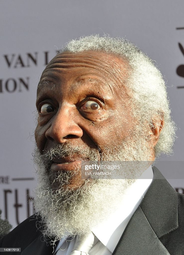 Activist and comedian Dick Gregory arrives for the opening gala of the historic Howard Theater in Washington, DC on April 12, 2012. First opened in 1910 in the 'Black Broadway' neighborhood of the capital, it has remained closed for the past 32 years until reopening on April 09, 2012. In its heyday, the Howard Theater featured vaudeville, live theater, musicals and local talents shows, bringing the newest and biggest names of the era in black entertainment. Some of the most celebrated entertainers who performed there include Duke Ellington, Ella Fitzgerald, Billy Eckstine, Sarah Vaughn, Sammy Davis Jr., Aretha Franklin, James Brown, Marvin Gaye and Miles Davis. AFP PHOTO / Eva HAMBACH