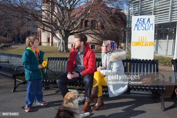 Activist and founder of Ask A Muslim program Mona Haydar and husband Sebastian Robins are photographed with dog Ben Ben for People Magazine on...