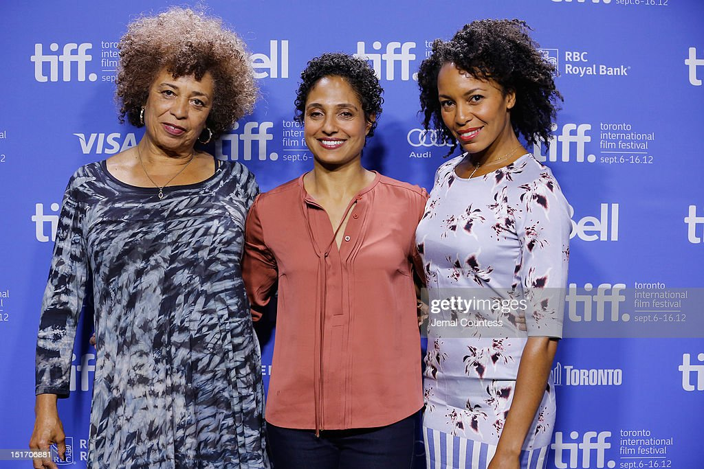 Activist <a gi-track='captionPersonalityLinkClicked' href=/galleries/search?phrase=Angela+Davis+-+Activist&family=editorial&specificpeople=233774 ng-click='$event.stopPropagation()'>Angela Davis</a>, director Shola Lynch and actress Eisa Davis attend the 'Free Angela & All Political Prisoners' Photo Call during the 2012 Toronto International Film Festival at TIFF Bell Lightbox on September 10, 2012 in Toronto, Canada.