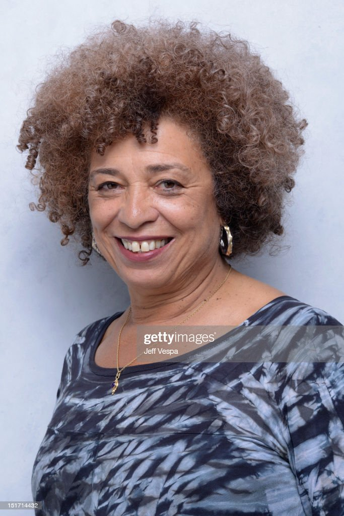Activist <a gi-track='captionPersonalityLinkClicked' href=/galleries/search?phrase=Angela+Davis+-+Activist&family=editorial&specificpeople=233774 ng-click='$event.stopPropagation()'>Angela Davis</a> of 'Free Angela & All Political Prisoners' poses at the Guess Portrait Studio during 2012 Toronto International Film Festival on September 10, 2012 in Toronto, Canada.