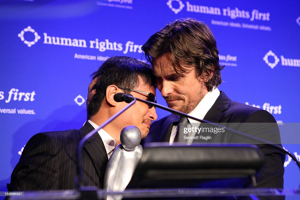 Activist Chen Guangcheng and Christian Bale attend the 2012 Human Rights First Awards at Pier Sixty at Chelsea Piers on October 24 2012 in New York...
