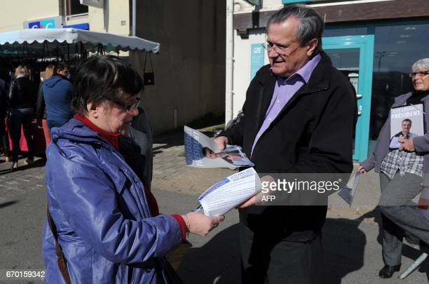 Activist distribute campaign leaflets for French presidential candidate Jean Lassalle few days ahead of the vote's first round on April 18 2017 in Le...
