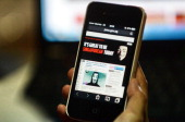 Activist hacker group Anonymous is seen through the internet government website of Singapore Prime Minister Office circulated online on a smartphone...