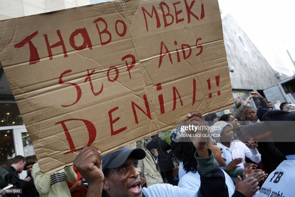 activist holds a banner 10 August 2007 as his comrades sing and dance after South African axed Health deputy minister Nozizwe MadlalaRoutledge gave a...