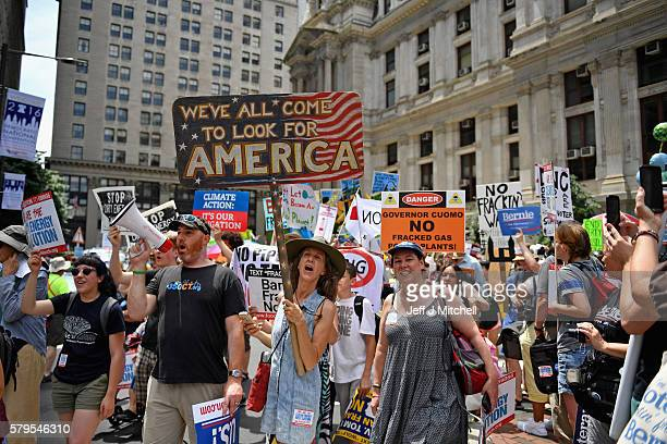 Activist including hundreds of environmentalists and Bernie Sanders supporters march through downtown before the start of the Democratic National...