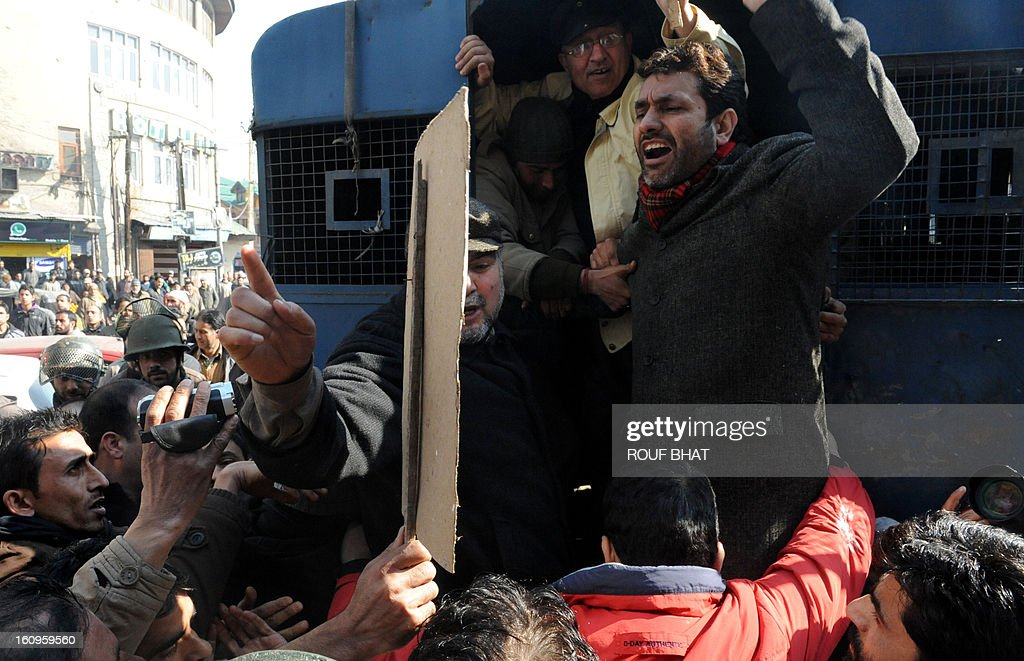 Activist Javeed Ahmad Mir shout slogans as police detain members of pro-independence group Jammu and Kashmir Liberation Front (JKLF) during a protest in Srinagar on February 8, 2013. The group were demanding the return of the remains of their founding leader, Maqbool Bhat who was hanged in an Indian jail in February 11, 1984 and buried there. AFP PHOTO/Rouf BHAT