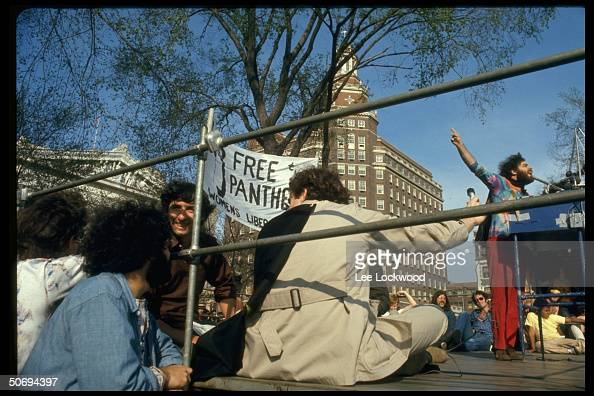 Activist Jerry Rubin giving podium speech at Yale Univ rally in support of Black Panthers fellow activist Tom Hayden