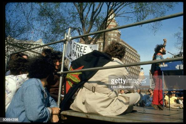 Activist Jerry Rubin giving podium speech at Yale Univ rally in support of Black Panthers
