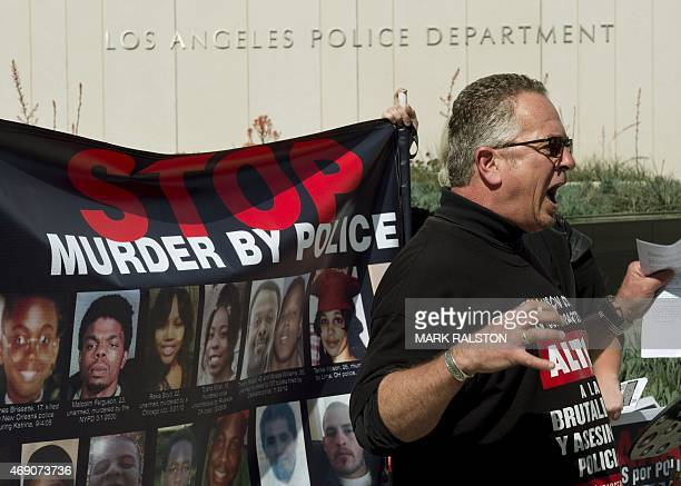 Activist Keith James speaks during a protest against the recent police shooting investigation in South Carolina outside LAPD headquarters in Los...