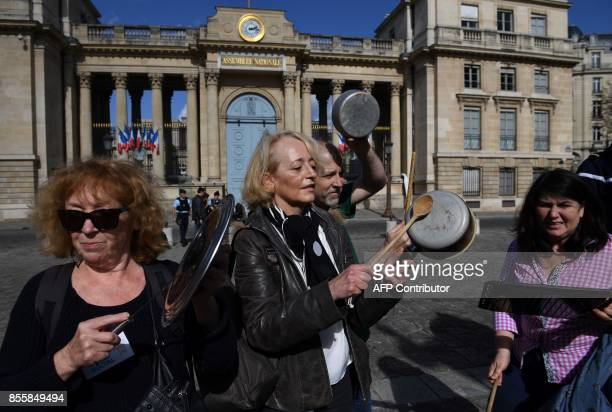 Activist makes noise with kitchen utensils during a demonstration called for by La France Insoumise leftist party parliamentary group President...