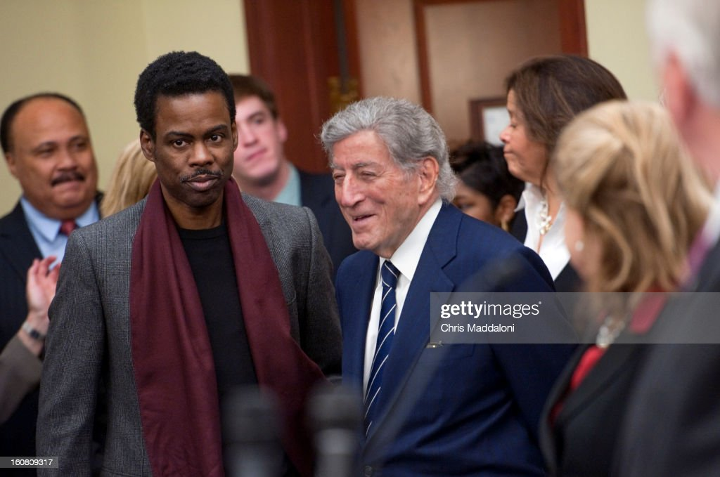 Activist Martin Luther King, III; comedian Chris Rock; and singer Tony Bennett arrive to speak at a press conference at the U.S. Capitol to call on Congress to act on President Obama's plan to reduce gun violence, including background checks for all gun sales and an assault weapons ban.