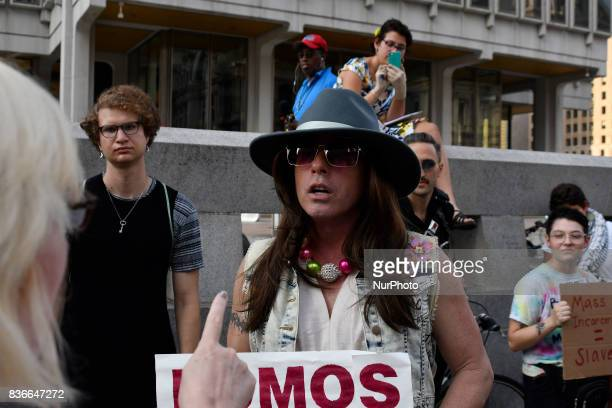 Activist Mike Hisey is seen in discussion with a bystander as protestors demand the removal of the Frank Rizzo statue at a rally near City Hall in...