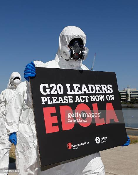 Activist mimicking front line Ebola health workers protest to demand G20 action to fight the disease on November 15 2014 in Brisbane Australia World...
