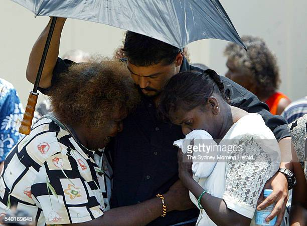 Activist Murandoo Yanner comforts mourners at the funeral of Cameron Doomadgee who died in police custody on Palm Island Queensland 11 December 2004...