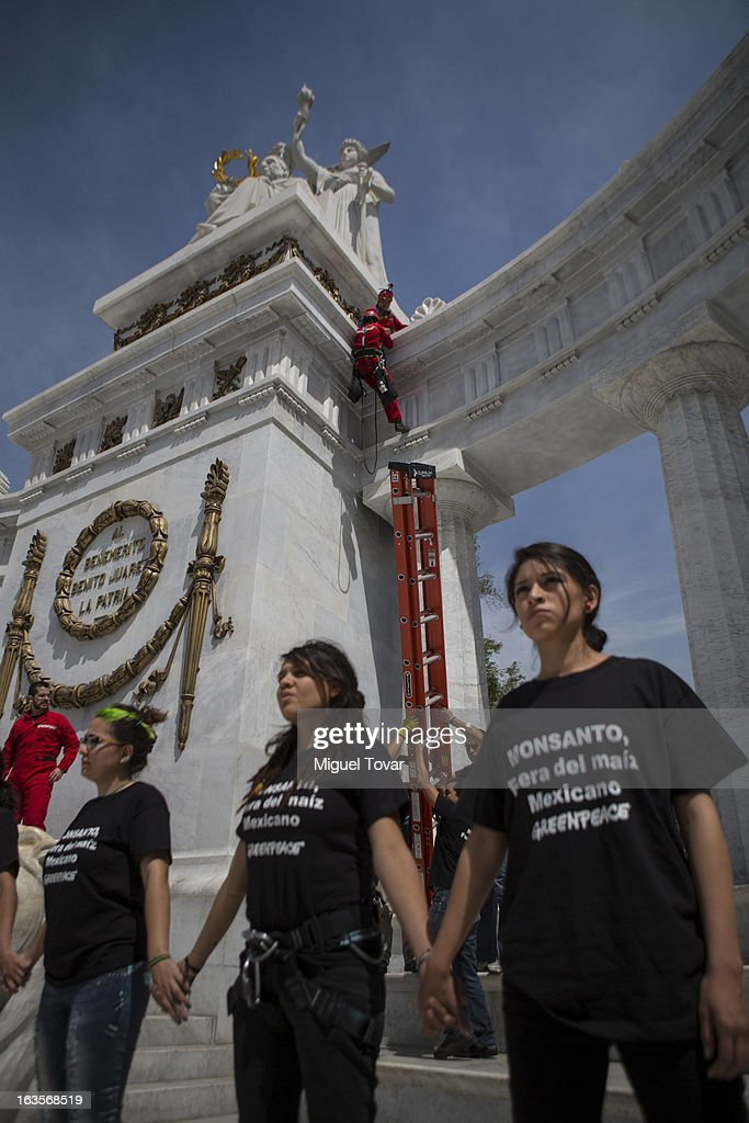 Activist of Greenpeace climbs the Juarez monument as he takes part in a protest against the use of transgenic corn on March 12, 2013 in Mexico City, Mexico.