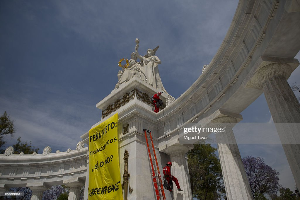 Activist of Greenpeace descends the Juarez monument as he takes part in a protest against the use of transgenic corn on March 12, 2013 in Mexico City, Mexico.