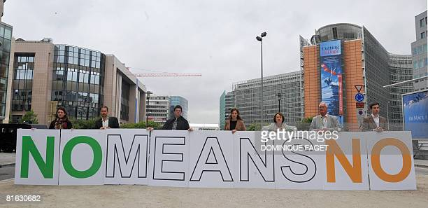 Activist of Open Europe thinktank display a banner in the colours of the Irish flag to urge EU leaders too stop the ratification process of the...