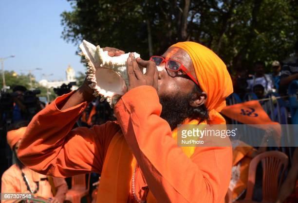 Activist of Viswa Hindu Parishad sounds Sankha during the rally on the eve of Hanuman Jayanti festival in Kolkata India on Tuesday 11th April 2017...
