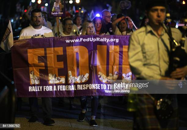 Activist participate in a march from the Ellipse to the White House August 31 2017 in Washington DC FED UP Coalition hosted its annual International...