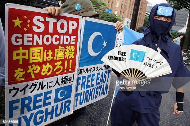 Activist protests in front of Japan National Press Center where Rebiya Kadeer president of World Uyghur Congress delivered a press conference at on...