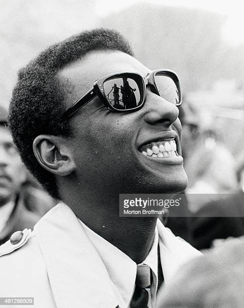Activist Stokely Carmichael listens to Dr Martin Luther King Jr deliver his 'How Long Not Long' speech in Montgomery Alabama at the culmination of...