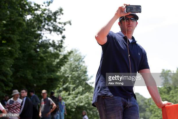 Activist Titus Frost monitors incoming traffic at the entrance of Westfield Marriott Hotel where the Bilderberg Meeting takes place June 1 2017 in...