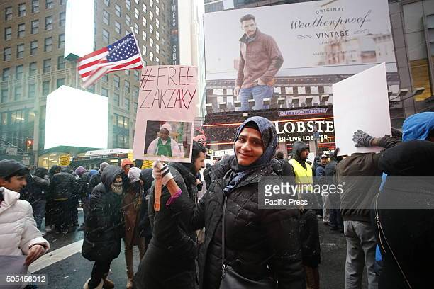 Activist with Free Zakzaky sign Hundreds of Muslims gathered in Times Square to protest against the Saudi government's execution of dissident sheikh...